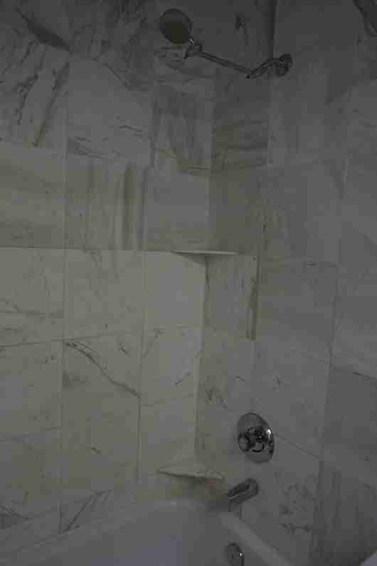 Notice the yellowing tile around the base of the shower