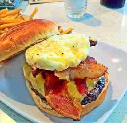 Create your own burgers (like this one with egg, cheddar and bacon) at MIA
