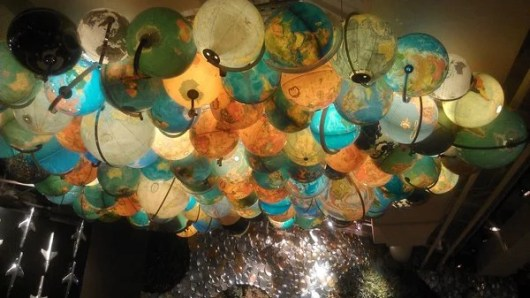 At DEN's Root Down, the decor (like this ceiling full of globes) is as innovative as the farm-to-table cuisine