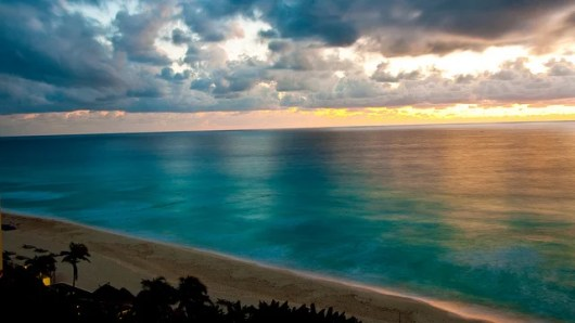 It's a Cancun tradition to stay up and watch the first sunrise of the new year (Photo by Chris Bickham/Flickr)