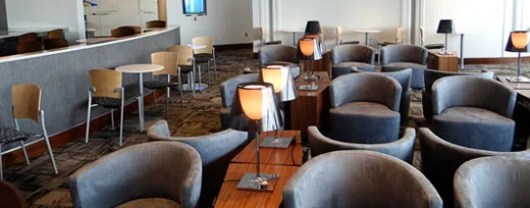 You'll find cushy chairs and lots of outlets for $35/day at The Club at ATL.