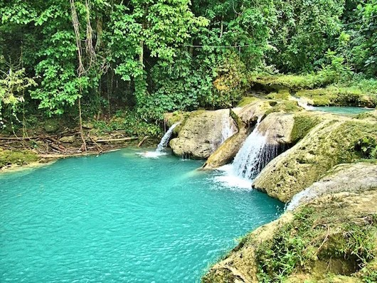 Blue holes and waterfalls in beautiful Jamaica. Photo courtesy of Shutterstock.