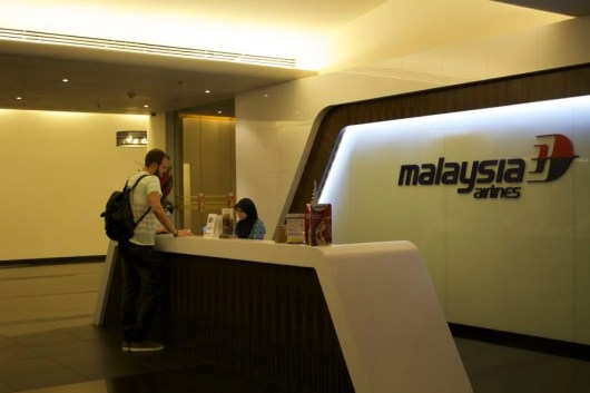 Check in at Malaysia Airlines.