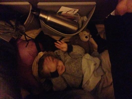 child sleeping on the bulkhead floor