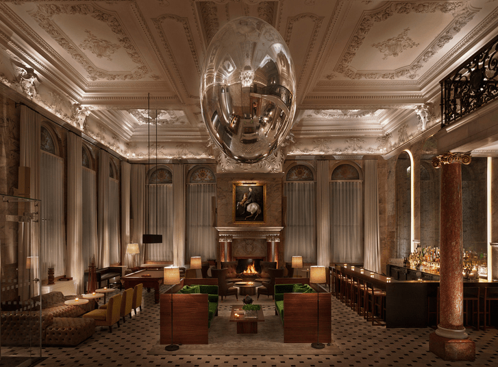 The lobby at The London Edition is a mix of modern art and vintage townhouse details.