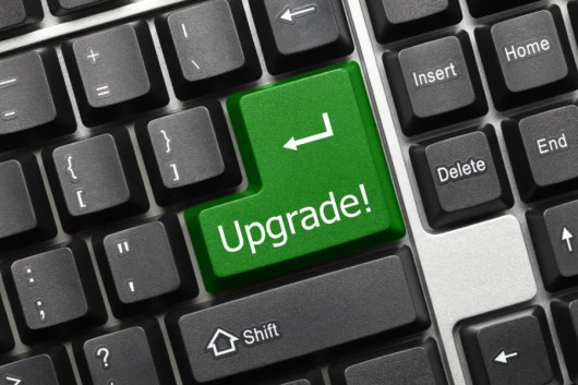 If you upgrade with points or miles, expect to earn economy miles. Photo courtesy of Shutterstock.