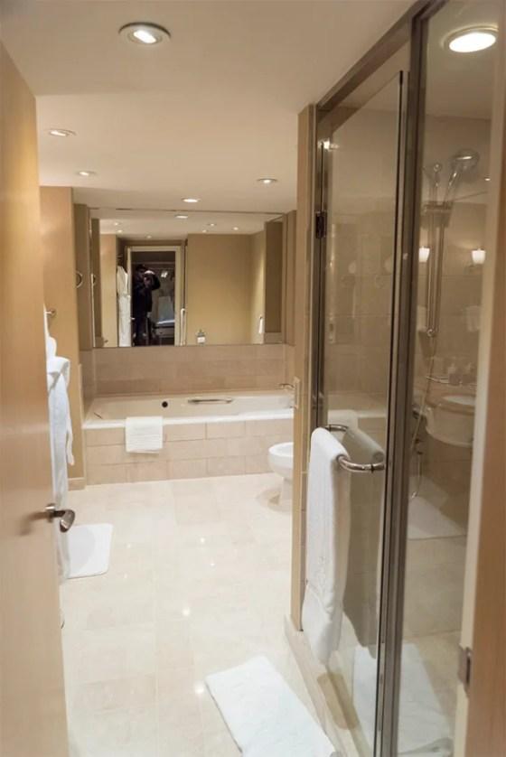 Roomy, calming, good lighting in the bathroom.