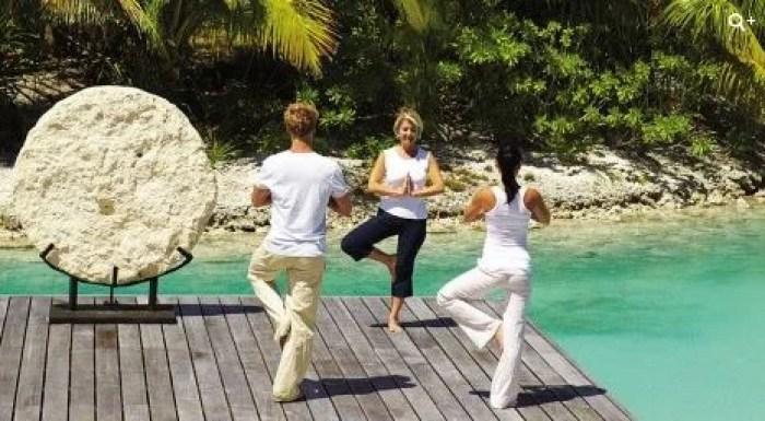 Who doesn't love at over-water yoga platform at the Four Seasons Bora Bora?