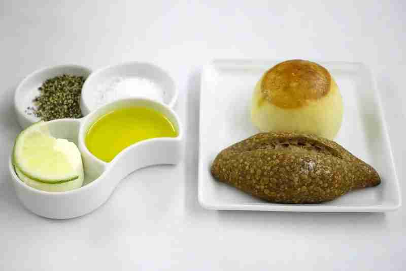 Bread with salt and pepper, olive oil and butter in ANA first class.