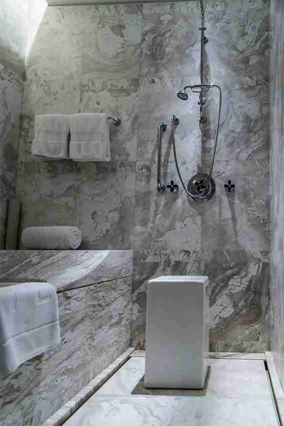 Marble-a-go-go in the bath & shower area.