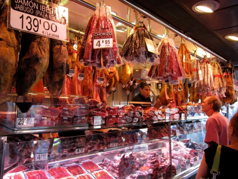 Food hall La Boqueria — and Barcelona itself — is famous for its fine selection of jamon (ham). Photo by Sean Munson / Flickr.