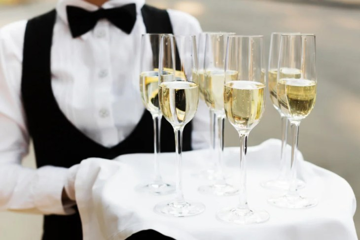 Knock back wedding costs by offering a Champagne toast — and a cash bar. Photo courtesy of Shutterstock.