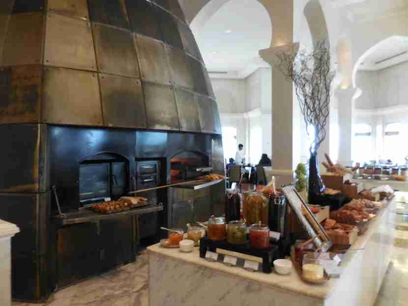 A massive wood-burning oven is the centerpiece of Cafe Arabesque and breakfast each morning.