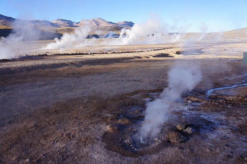 El Tatio Geyser Field lies 14,000 feet above the desert floors — and it's cold up there.