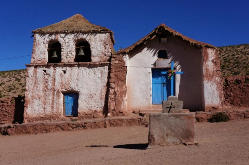 The church overlooking the tiny village of Machuca, way out in the desert.