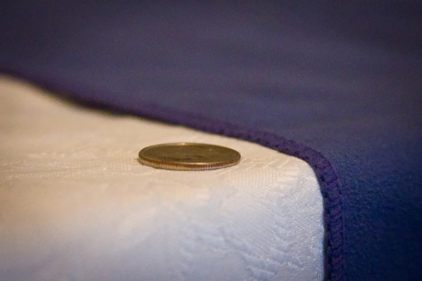 Microfiber towels are ultra-thin and light.  On the left is a US dime.  On the right, a microfiber towel.