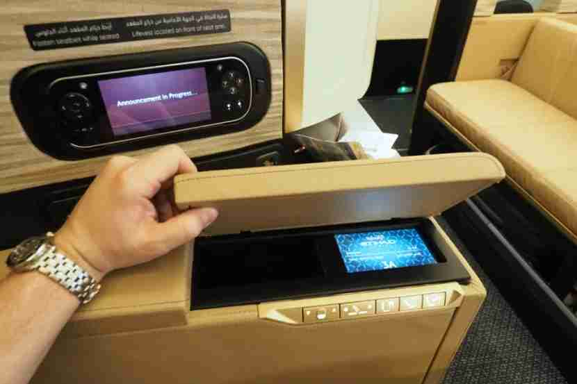 A touchscreen located under the armrest includes seat and lighting controls.