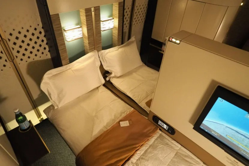 With the partition lowered, you can have an in-flight double bed.
