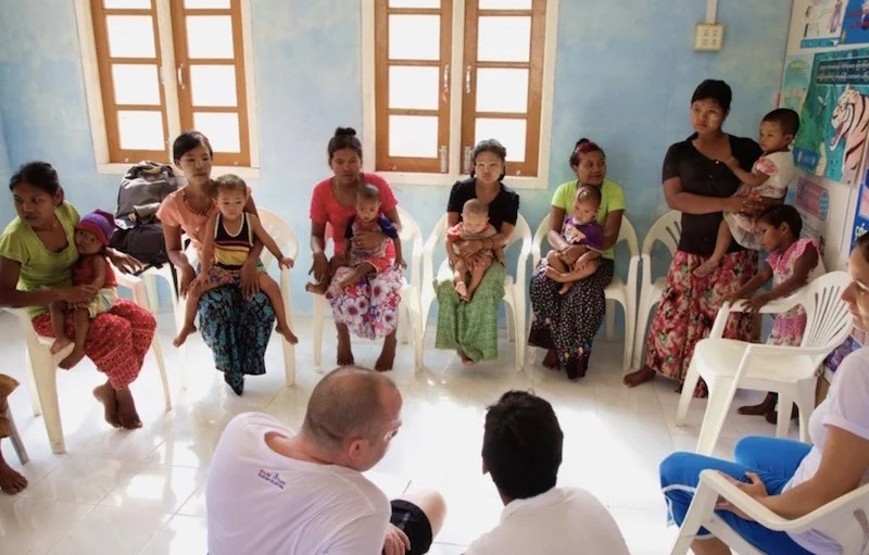 Working with mothers and babies on the first Sailing Clinic's mission. Photo courtesy of Burma Boating.