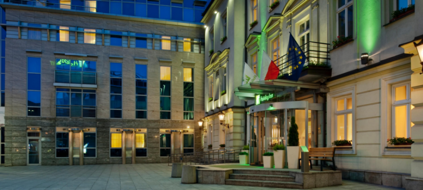 The main entrance to the Holiday Inn Krakow hints at the building's historic past.