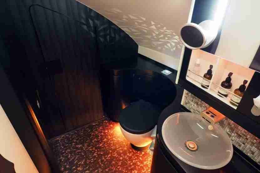 The main first-class lavatory occupies the same space as The Residence bedroom on the other side of the plane.