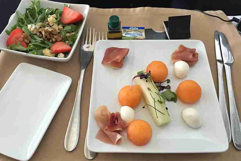 Plane food? My mozzarella, prosciutto and cantaloupe appetizer sure beats out the salad in economy.