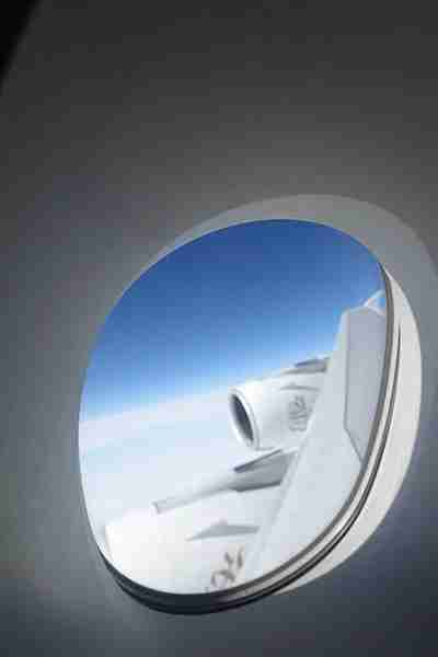 The rear first-class bathroom has a window overlooking the wing.