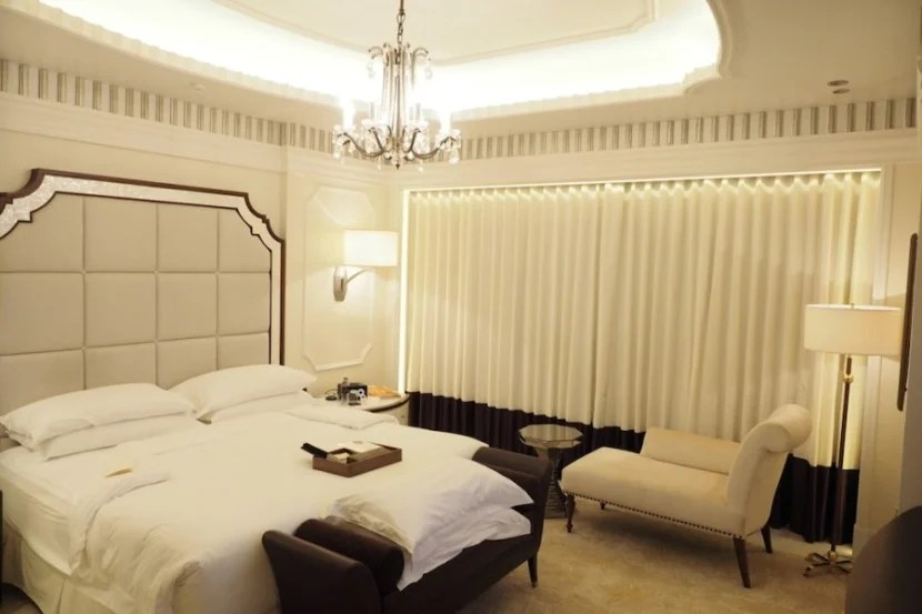 AN absolutely gorgeous bedroom, with yet another chandelier.