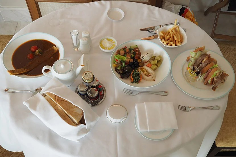 A room-service lunch of tomato soup, mezze and a club sandwich.