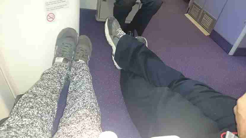 Stretching out in exit row 50 after we switched seats