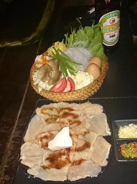 Lao Fondue: Fresh meat and vegetables you cook at your table