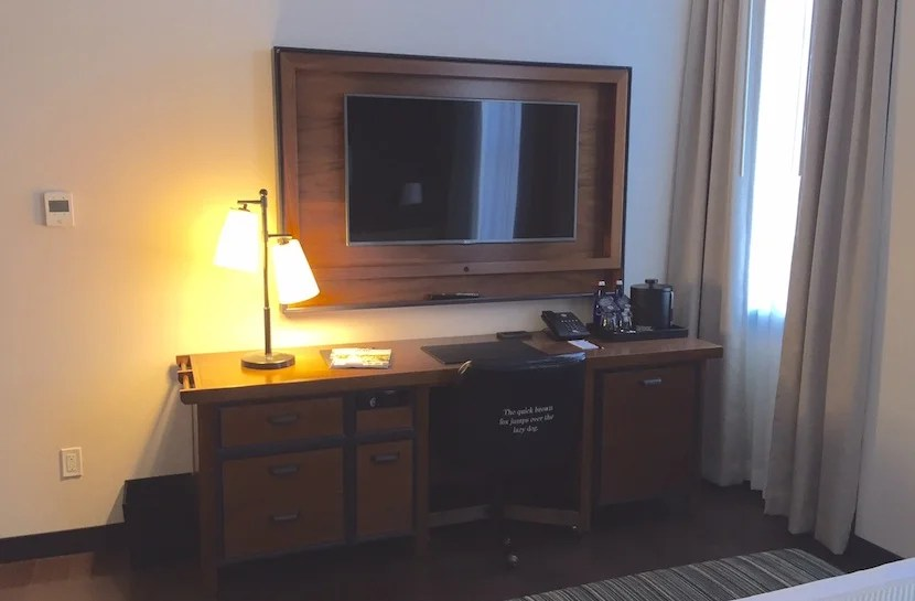 The vintage-style desk and TV.
