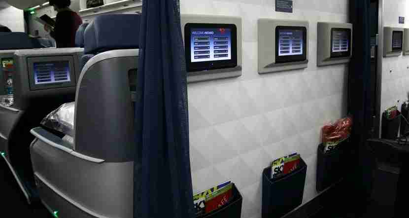 The entertainment screens from the bulkhead Delta Comfort+ middle row and the back of Delta One.