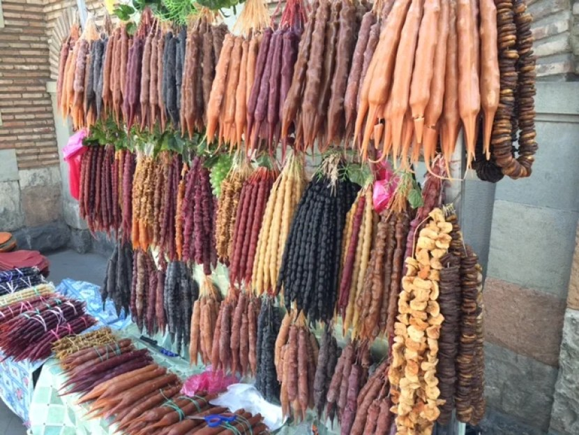 Delicious Churchkhela candies hanging for sale at a roadside stand.