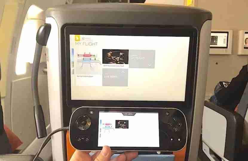 The IFE screen and remote control on a non-bulkhead seat.