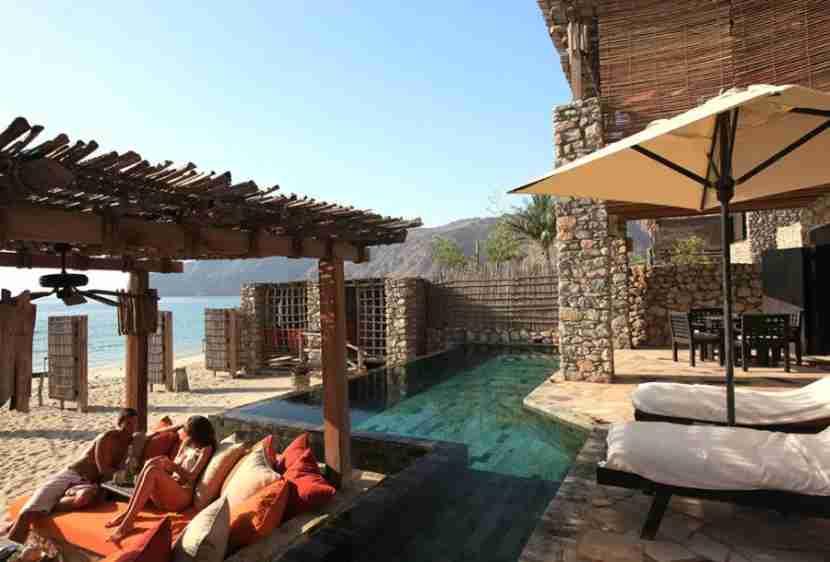 Splurge on a stay at the Six Senses Zighy Bay. Photo courtesy of Six Senses.