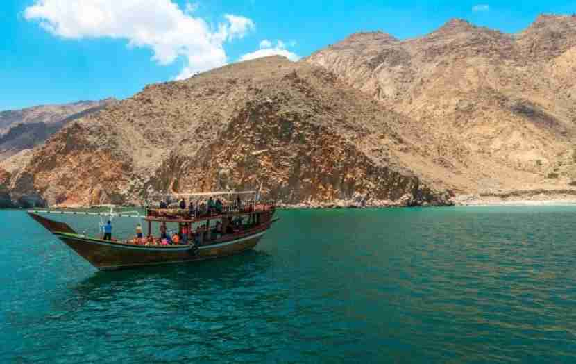 Take a dhow cruise through the jaw-dropping desert fjords of Oman. Photo courtesy of Shutterstock.