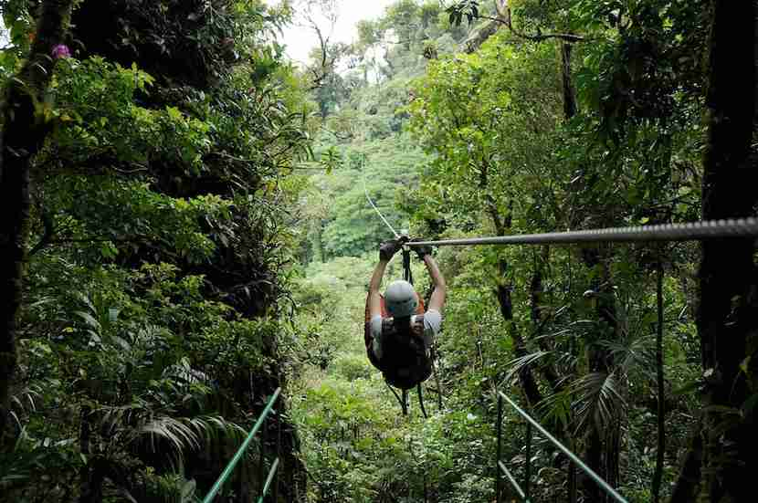 Zipline through the rain forest canopy alongside scenic the Arenal volcano.