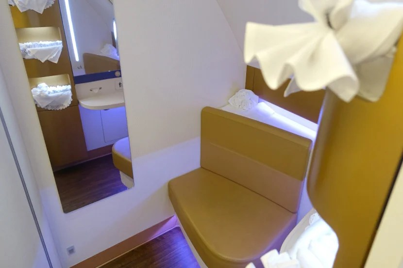 The forward lav has a separate sitting area.