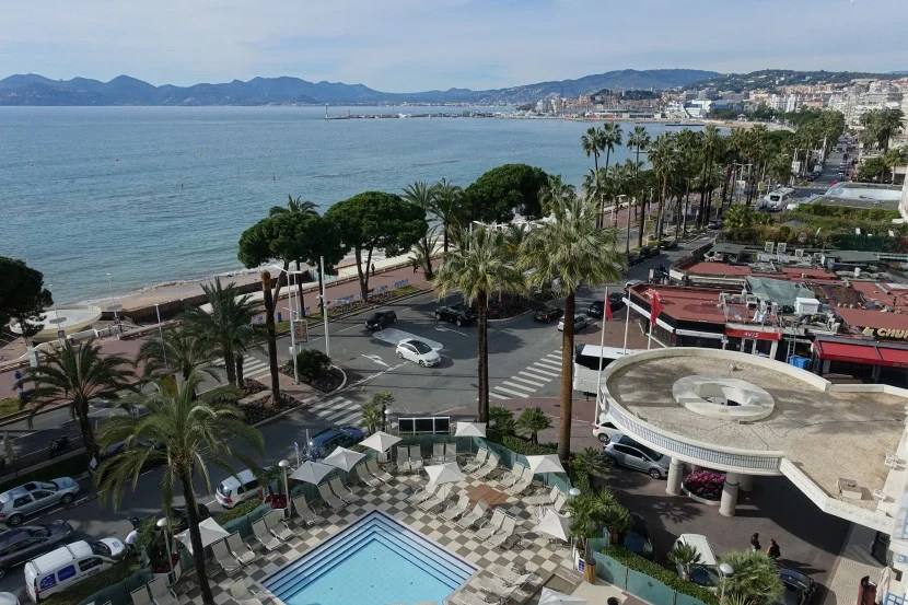 More of the beach, and Cannes' Le Suqet old quarter, seen from our balcony.