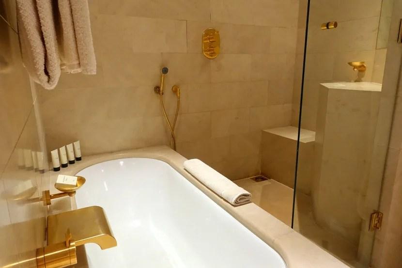 The unique bathtub and shower setup.