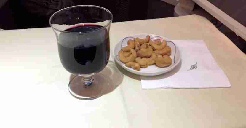 Service started with drinks and cashews.