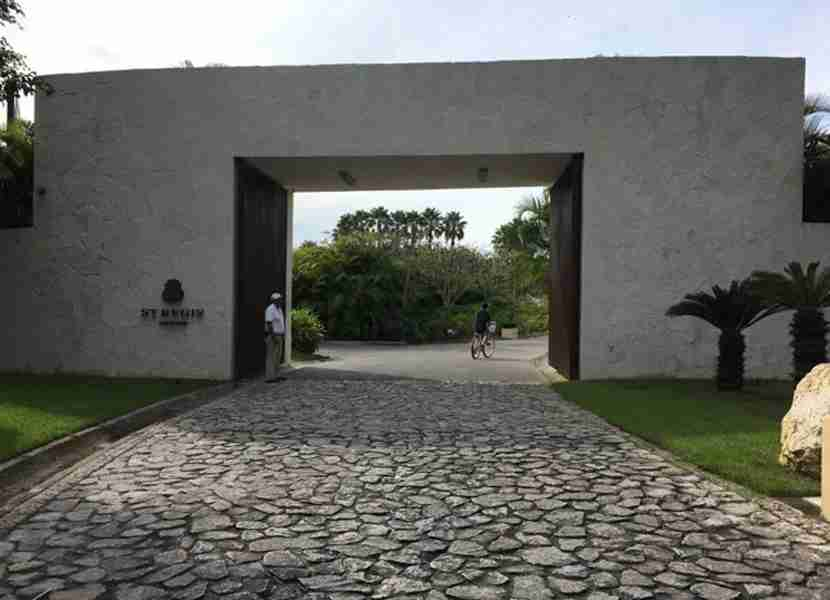 The cobblestone driveway and gate leading to the resort.