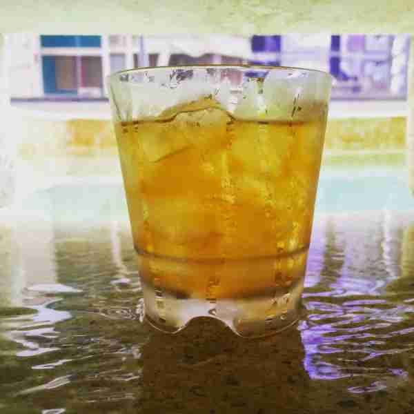 A glass of Ron Abuelo poolside at the Waldof Astoria Hotel.