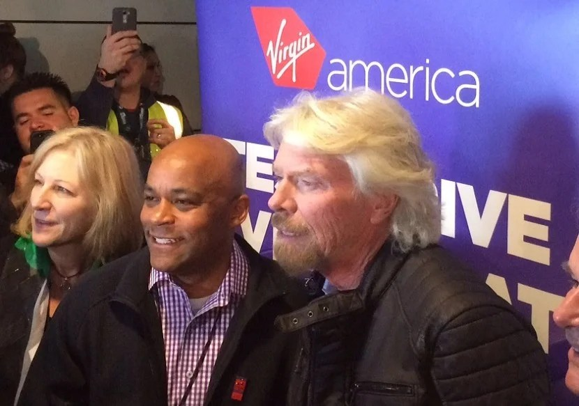 Sir Richard Branson, Mayor Michael Hancock, and Kim Day, director of Denver International Airport.