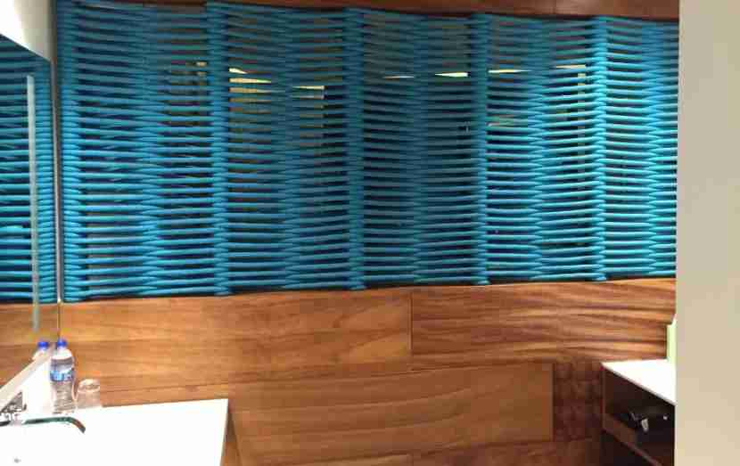 The decor of the room was predominantly white with wood paneling and blue accents.