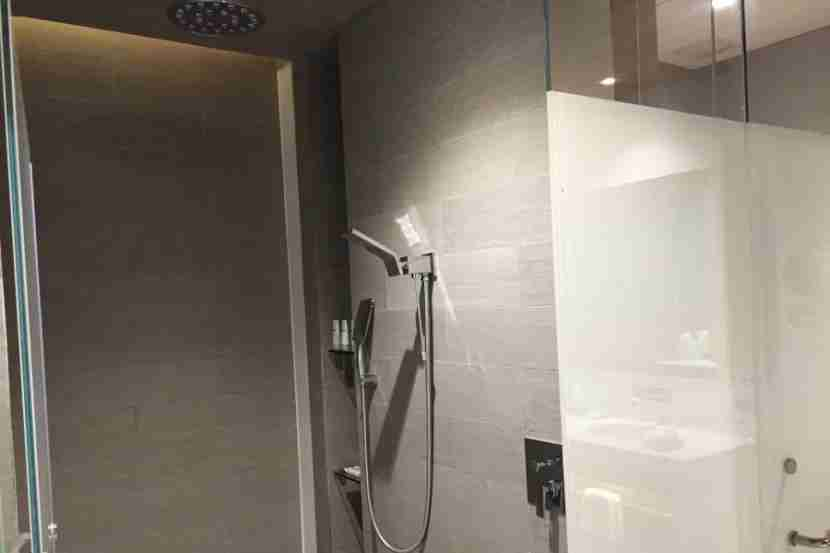 The shower in the room.