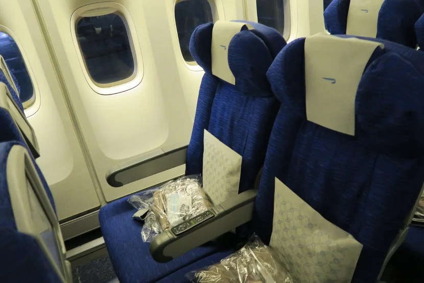 Row 51 is the first of three 2-4-2 rows and, thus, featured extra space between the seat and window.