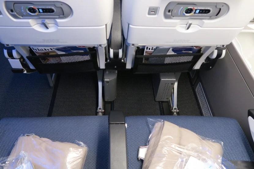The entertainment box split the window seat's leg room in half.