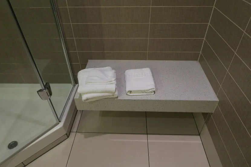The bench in the shower room was useful for holding belongings as well as sitting.